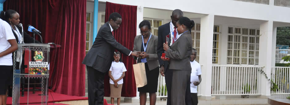 2nd Best Team, Kabarak University's Wilkister Mumbi and Owuor Thatcher receive an award from Prof PLO Lumumba.jpg